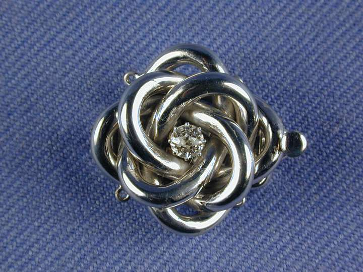 Antique diamond set knot clasp, with a central diamond
